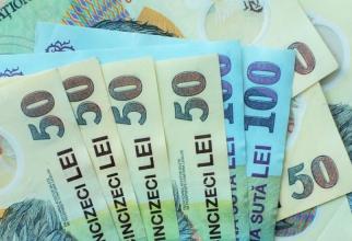 Moneda naţională s-a depreciat miercuri în raport cu euro