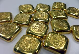 Gramul de aur ajunge la un nou preț record