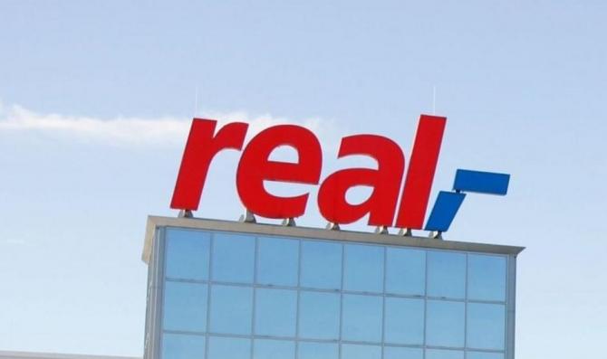 Retailerul german Metro AG a ajuns marţi la un acord privind vânzarea lanţului său de hipermarketuri Real