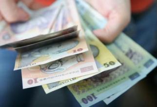Moneda naţională s-a depreciat marţi în raport cu euro