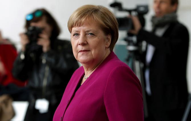 Merkel spune că societatea americană este foarte divizată