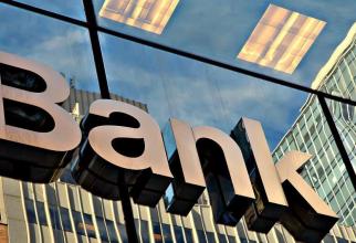 CaixaBank şi Bankia formează cel mai MARE grup bancar spaniol