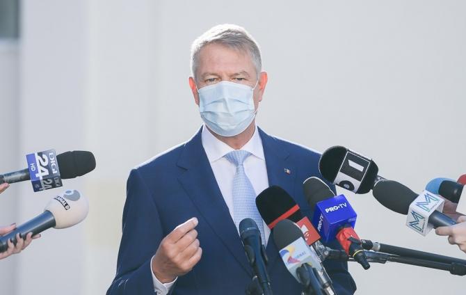 Iohannis a promulgat legea prin care evazioniştii care achită prejudiciul scapă de închisoare