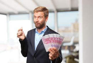 În mod normal salariile nu pot fi plătite în euro în România